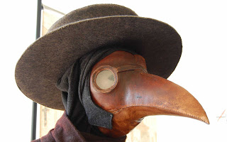 The beak was made from bronze, filled with medicinal and aromatic herbs to filter the bad air and mask the stench of ruptured buboes and human corruption. The doctor breathed through two small holes in the mask with garlic in his mouth, incense in his ears and a bone in his nose ho ho.